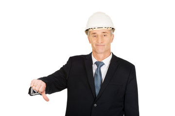 Construction businessman showing thumbs down