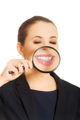 Businesswoman with magnifying glass.