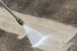 Leinwandbild Motiv Outdoor floor cleaning with high pressure water jet