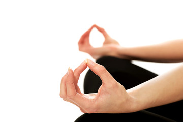 Woman hands in ohm yoga pose
