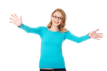 Happy teenage woman with arms wide open