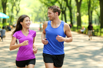 Running couple training in Central Park, New York