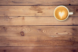 coffee on wood table texture with space for text poster