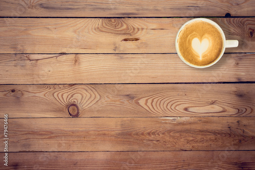Poster Koffie coffee on wood table texture with space for text