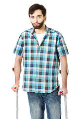 Young disabled man with crutches.