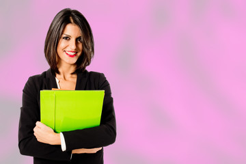 smiling professional woman on pink background