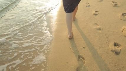 Female feet on a sandy beach