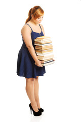 Overweight woman holding books