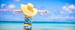 Leinwandbild Motiv Little girl in big yellow hat on white sandy beach