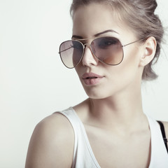 Beautiful girl with sun glasses. Sexy woman. Fashion girl.