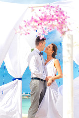 young loving couple on their wedding day, beautiful wedding arch