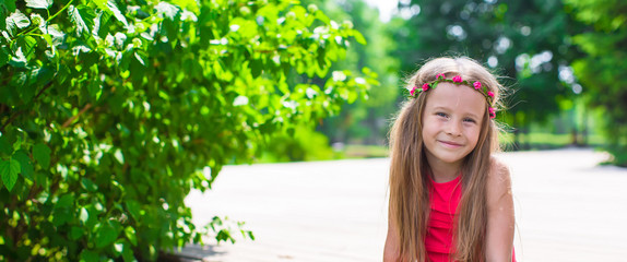 Portrait of adorable little girl on a warm summer day