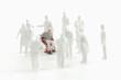 Kunststoff-Figur sitzt im Rollstuhl - 79483694