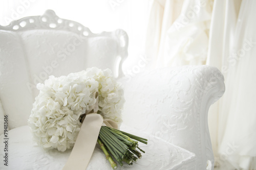 Pure white bouquet and wedding dress