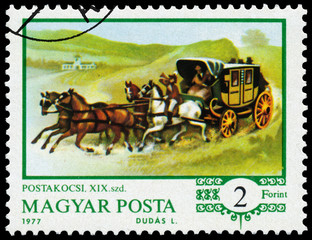 Stamp printed in the Hungary shows Mail Coach