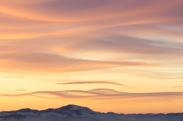 Colorful winter sky with clouds over the island of Olkhon on Bai