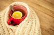 Sickness concept: Cup of hot tea and lemon wrapped with a scarf - 79485018