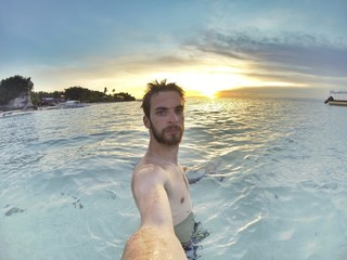 Selfie on tropical beach with sunset