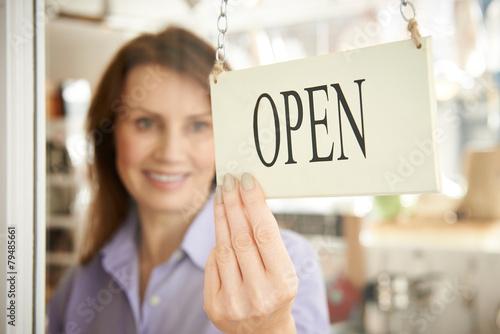 Leinwanddruck Bild Store Owner Turning Open Sign In Shop Doorway