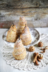 Baked pears with sesame seeds and cinnamon in puff pastry