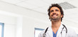 Portrait of a smiling doctor in a clinic room - 79488864