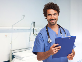 Portrait of a smiling doctor in a clinic room