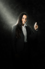 Smiling businesswoman giving a thumbs up gesture