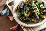 Moules Marinieres - Mussels cooked with white wine sauce - 79489635