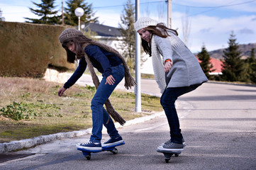 Two girls playing with a wave board. Skateboard