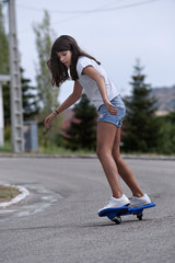 Girl playing with a wave board. Skateboard