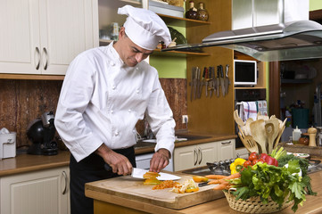 Chef preparing food in a kitchen