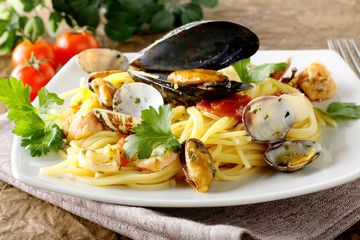 Spaghetti with salmon, clams and mussels