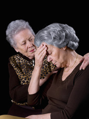 Old woman, comforting a friend