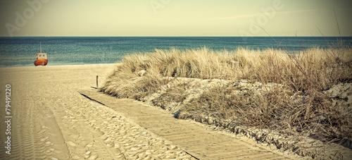 Fototapeta Retro toned panoramic photo of a beach.