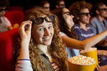 Young friends watching a 3d film