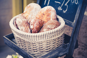 Wholemeal bread in a basket in the bakery.