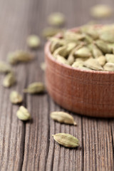 Green cardamom super food ayurveda asian aroma spice in a wooden