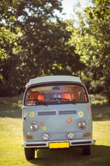 Retro camper van in a field