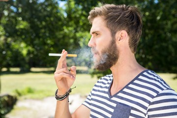 Hipster smoking electronic cigarette