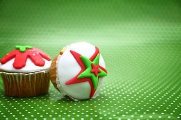 Festive Christmas cupcakes on green polka dot background