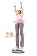 Composite image of young woman cheering on weight scale