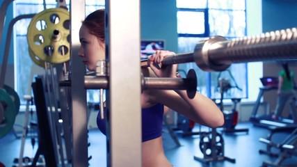 two girls hard squats