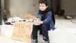 Homeless child begging in street
