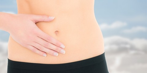 Fit woman with stomach pain