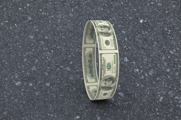 Composite image of wheel of dollars