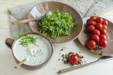 Watercress salad with cherry tomatoes and sour cream