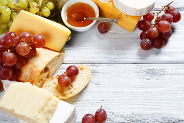 Various types cheese on a background of boards
