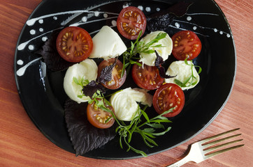Ingradients for Italian caprese salad with fresh basil leaves