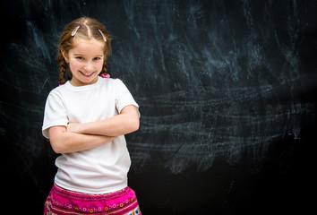 little girl on a background of school board