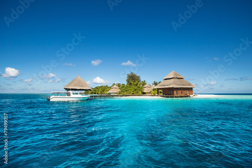 Poster Eiland small tropical island with Beach Villas and speed boat